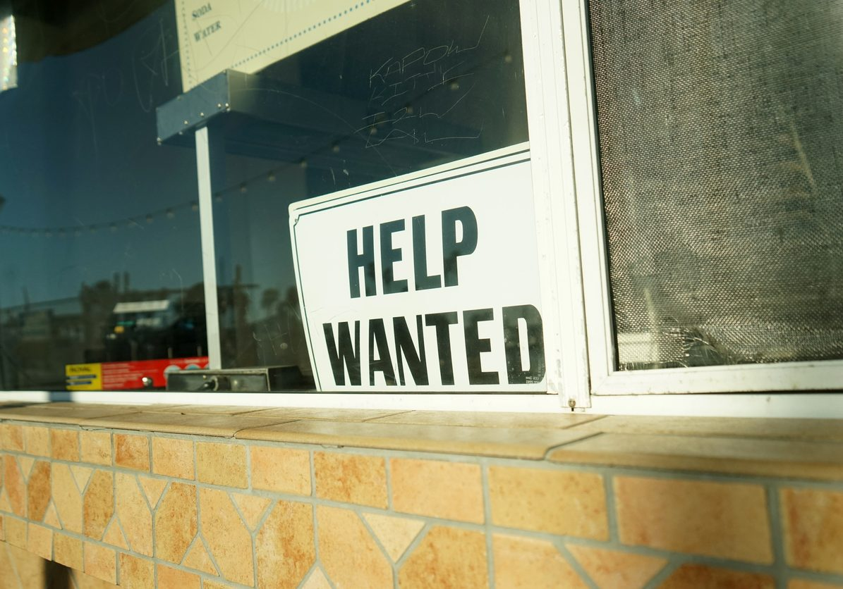 shot of help wanted sign
